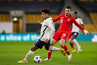 13th October 2020; Molineux Stadium, Wolverhampton, West Midlands, England; UEFA Under 21 European Championship Qualifiers, Group Three, England Under 21 versus Turkey Under 21; James Justin of England turns quickly with the ball at his feet chased by Ogulcan Ulgun of Turkey