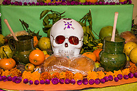 Oaxaca, Mexico, North America.  Day of the Dead Celebrations.  Altar Decorations in Memory of the Dead.  Doll Skeletons, Skull, Flowers, Marigolds, Pan de Muertos.