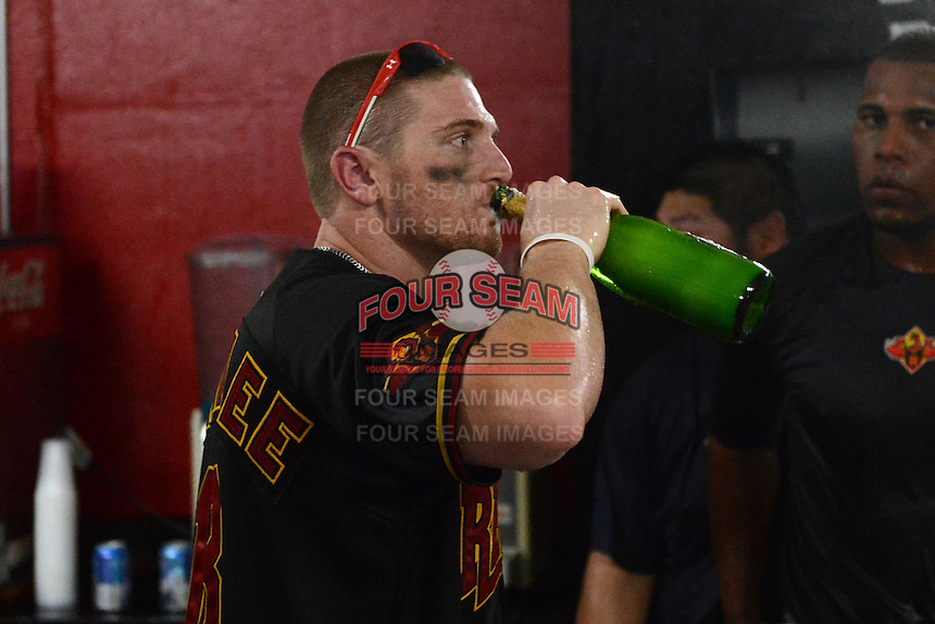 Rochester Red Wings outfielder Chris Pamelee (18) celebrates in the locker room after defeating the Scranton Wilkes Barre RailRiders on September 2, 2013 at Frontier Field in Rochester, New York to clinch the International League Wild Card Playoff spot.  (Mike Janes/Four Seam Images)