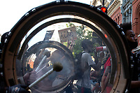 """An """"A.C.A.B"""" sign is seen through the drum of a marching band as demonstrators march to Interstate 395 in Washington D.C., U.S., on Tuesday, June 23, 2020.  Trump tweeted that he authorized the Federal government to arrest any demonstrator caught vandalizing U.S. monuments, with a punishment of up to 10 years in prison.  Credit: Stefani Reynolds / CNP/AdMedia"""