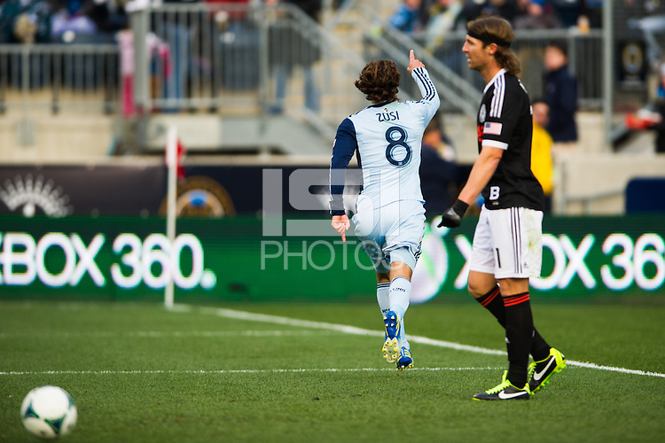 Graham Zusi (8) of Sporting Kansas City celebrates scoring during the first half against the Philadelphia Union during a Major League Soccer (MLS) match at PPL Park in Chester, PA, on March 2, 2013.