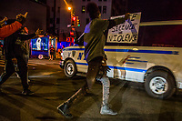 NEW YORK, NEW YORK - MAY 31: Protesters yell at a police patrol on May 31, 2020 in New York. Protests spread across the country in at least 30 cities in the United States. USA For the death of unarmed black man George Floyd at the hands of a police officer, this is the latest death in a series of police deaths of black Americans (Photo by Pablo Monsalve / VIEWpress via Getty Images)
