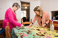 FAO: Society <br /> Pictured: Alys Phillips (R) helping resident Mandy Patton lay the dinner table<br /> Re: Care worker Alys Phillips, 23, who looks after people with learning disabilities in Brecon, mid Wales, UK. Wednesday 01 February 2017