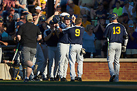 Kyle Gray (9) of the West Virginia Mountaineers is greeted by teammates after scoring a run in the top of the first inning against the Wake Forest Demon Deacons in Game Four of the Winston-Salem Regional in the 2017 College World Series at David F. Couch Ballpark on June 3, 2017 in Winston-Salem, North Carolina. The Demon Deacons walked-off the Mountaineers 4-3. (Brian Westerholt/Four Seam Images)