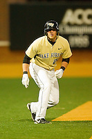 James Harris #22 of the Wake Forest Demon Deacons takes his lead off of third base against the Northwestern Wildcatsd at Gene Hooks Field on February 26, 2011 in Winston-Salem, North Carolina.  Photo by Brian Westerholt / Four Seam Images