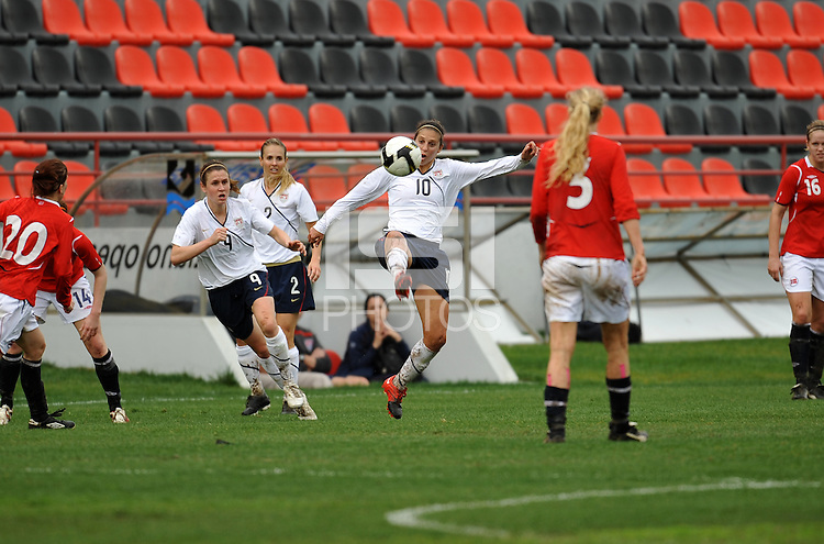 Carli Lloyd makes an acrobatic play on the ball. The USA defeated Norway 2-1 at Olhao Stadium on February 26, 2010 at the Algarve Cup.