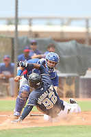 Melvin Novoa (8) of the AZL Rangers tags out Westhers Magdaleno (92) of the AZL Padres during a game at the San Diego Padres Spring Training Complex on July 4, 2015 in Peoria, Arizona. Padres defeated the Rangers, 9-2. (Larry Goren/Four Seam Images)
