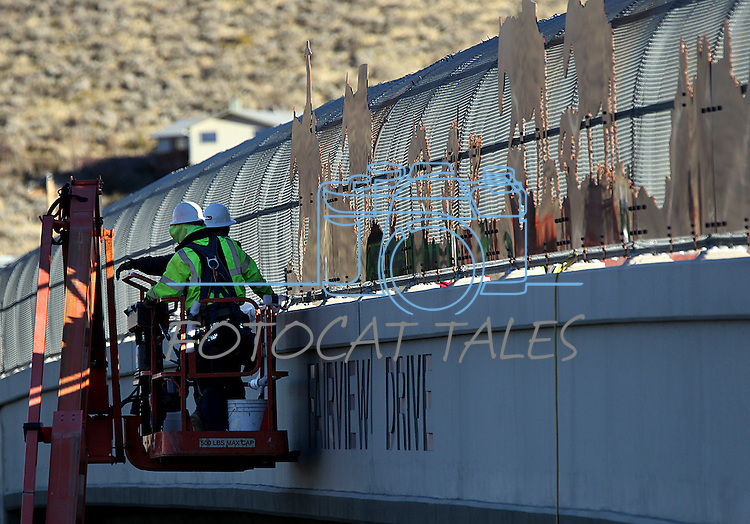 """A Q&D Construction crews installs """"cattle drive image panels"""" on the Fairview overpass above the Highway 395 freeway on Monday afternoon in Carson City. The work, which is part of the Carson City Freeway Landscape Project that includes landscape, art and history along the freeway corridor, will continue through the week..Photo by Cathleen Allison.Photo by Cathleen Allison"""