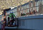 "A Q&D Construction crews installs ""cattle drive image panels"" on the Fairview overpass above the Highway 395 freeway on Monday afternoon in Carson City. The work, which is part of the Carson City Freeway Landscape Project that includes landscape, art and history along the freeway corridor, will continue through the week..Photo by Cathleen Allison.Photo by Cathleen Allison"
