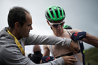 Daryl Impey (ZAF/Orica-BikeExchange) being helped out of his super-soaked race kit after the finish as to be able to start descending the summit asap towards the team hotel <br /> <br /> finish of stage 9 in Andorra Arcalis (coming from Velha Val d'Aran/ESP, 184km)<br /> 103rd Tour de France 2016