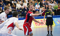08 JAN 2012 - LONDON, GBR - Great Britain playmaker Ciaran Williams (#3, in red) passes during the men's 2013 World Handball Championships qualification match against Austria at the National Sports Centre in Crystal Palace, Great Britain .(PHOTO (C) 2012 NIGEL FARROW)