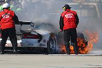The #33 Viper of Ben Keating, Jeroen Bleekemolen and Sebastian Bleekemolen catches fire early in the 12 Hours of Sebring, Sebring International Raceway, Sebring, FL, March 2014.  (Photo by Brian Cleary/www.bcpix.com)