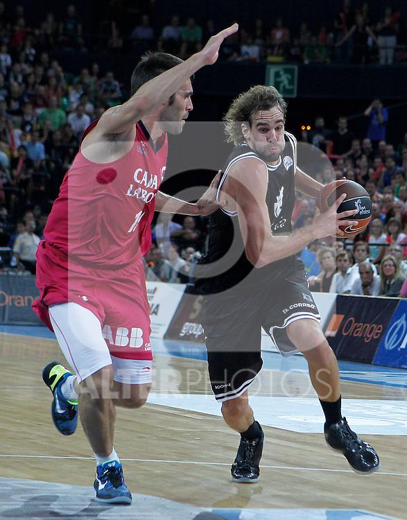 Bizkaia Bilbao Basket's Roger Grimau (r) and Caja Laboral's Fernando San Emeterio during Supercopa ACB Semifinal match.September 30,2011. (ALTERPHOTOS/Acero)