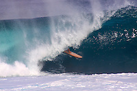 A surfer in the tube at Pipeline on the North Shore of O'ahu.