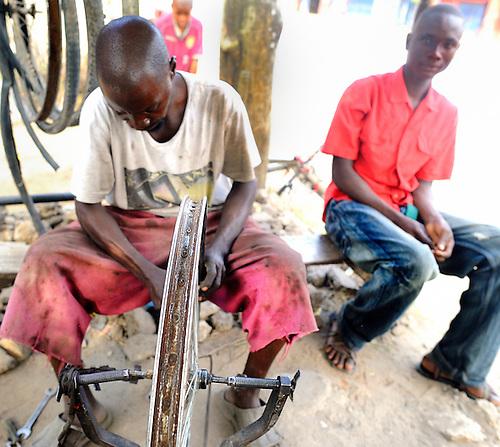 A bike repairman at his street front  shop in Likoni, Kenya.