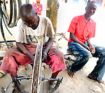 A bike repairman at his street front  shop in Likoni, Kenya.