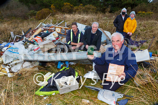 Cllr Charlie Farrelly who has found identification in the rubbish dumped in Ahaneboy Castleisland with residents middle row Pat and James Shanahan, back row: Seamus and Patrick Fleming