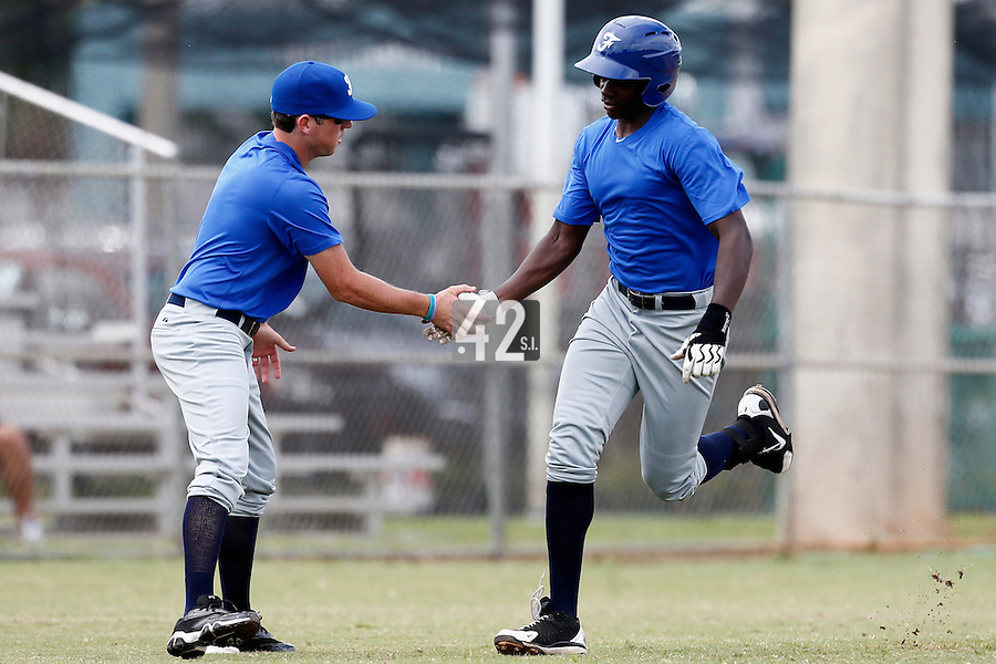 19 September 2012: Frederic Hanvi runs the bases as he is congratulated by Jeff Stoeckel after hitting a home run during Team France friendly game won 6-3 against Palm Beach State College, during the 2012 World Baseball Classic Qualifier round, in Lake Worth, Florida, USA.