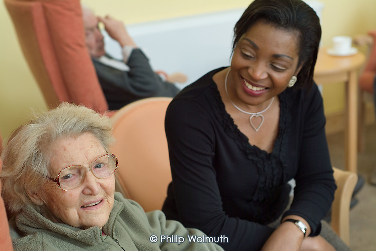 A member of staff with a resident of a Westminster Council sheltered housing scheme in Paddington, London