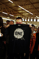 Bono, the lead singer of rock band U2, holds up a 'One' campaign T-shirt that has been manufactured in a textile factory in Lesotho as part of a scheme to help Africa develop markets and jobs.  Bono is visiting the region as part of the 'One' campaign to Make Poverty History.