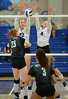 Rogers' Abby Harris (22) and Kate Miller (4) reach Tuesday, Oct. 13, 2020, to block a shot by Bentonville's Maddie Lee (23) during play in King Arena in Rogers. Visit nwaonline.com/201014Daily/ for today's photo gallery. <br /> (NWA Democrat-Gazette/Andy Shupe)
