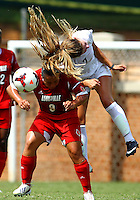 WINSTON-SALEM, NORTH CAROLINA - September 01, 2013:<br />  Charlyn Corral (9) of Louisville University is beaten to the ball by Sarah Teegarden (7) of Wake Forest University during a match at the Wake Forest Invitational tournament at Wake Forest University on September 01. The match was abandoned early in the second half due to severe weather with Wake leading 1-0.