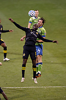 COLUMBUS, OH - DECEMBER 12: Gyasi Zardes #11 of Columbus Crew heads the ball in front of Gustav Svensson #4 of Seattle Sounders FC during a game between Seattle Sounders FC and Columbus Crew at MAPFRE Stadium on December 12, 2020 in Columbus, Ohio.
