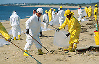 Oil spill clean up workers on beach. Cape May New Jersey USA beach.