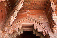 Fatehpur Sikri, Uttar Pradesh, India.   Doorway Showing Combined Hindu and Islamic Architectural Influences--Islamic Arch overhead and  Hindu Corbelled Arch underneath.   Birbal's Palace, Residence of the Emperor's Senior Wives.