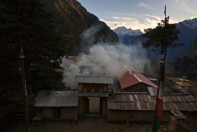 JUNIPER is burned as an offering near a TEMPLE at a remote TIBETAN BUDDHIST MONASTERY - NEPAL HIMALALA