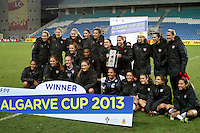 USA team celebrate with the trophy after their Algarve Women's Cup soccer match final against Germany at Algarve stadium in Faro, March 13, 2013.  .