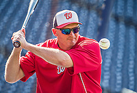 20 May 2014: Washington Nationals Bench Coach Randy Knorr taps out infield grounders prior to a game against the Cincinnati Reds at Nationals Park in Washington, DC. The Nationals defeated the Reds 9-4 to take the second game of their 3-game series. Mandatory Credit: Ed Wolfstein Photo *** RAW (NEF) Image File Available ***