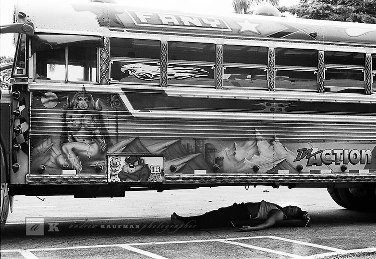 A Diablo Rojo bus driver catches a nap.