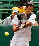 Juan Ignacio Chela of Argentina hits a backhand against Lleyton Hewitt of Australia in a quarter final tennis match at the US Men's Clay Court Championships at River Oaks Country Club in Houston, Friday, April 9, 2010. Chela defeated Hewitt 6-4, 6-3. (AP Photo/Steve Campbell)    .