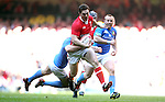 George North in full flight with Alberto Sgarbi in tow..2012 RBS 6 Nations.Wales v Italy.Millennium Stadium..10.03.12.Credit: STEVE POPE-Sportingwales