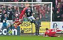 Dundee's Thomas Konrad (4) scores their first goal.