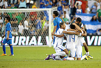 Honduras players celebrate at the end of the match... Honduras defeated El Salvador 3-2 after extra time to go through to the final at LIVESTRONG Sporting Park, Kansas City, Kansas.
