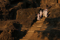 Jai shri krushni panth (mahanubhav pantheist)nuns visiting one of the ellora caves<br /> <br /> Aurangabad, India.The famous Ellora caves are located in the lap of the Chamadari hills. These historical caves are regarded as world heritage and are situated 18 miles northwest of Aurangabad.  .A wonderful example of cave temple architecture, the world heritage Ellora caves own elaborate facades and intricately carved interiors. These carved structures on the inner walls of the caves reflect the three faiths of Hinduism, Buddhism and Jainism. These exotic caves were carved during 350 AD to 700 AD period. .Ellora caves are hewn out of basaltic rock of the Deccan trap, and are datable from circa 5th century A.D. to 11th century A.D. In all 34 caves were excavated here out of which Cave 1 to 12 are Buddhist, 13 to 29 are Brahmanical and 30 to 34 are Jaina. Cave10 in AjantaCavescontains theoldest Indian paintingsof historical period, made around the 1st century BC.<br /> <br /> ThecavesatAjantadate from the 2nd century B.C.E. to 650 C.E andwerecut into the mountainside in two distinct phases. Discovered by chance in 1819 by British soldiers on a hunt, theAjanta Caveshave become an icon of ancient Indian art, and have influenced subsequent artists and styles.<br /> <br /> Thesepaintingsbeautifully depict various events in the life of Lord Buddha. All the caves are divided into two categories namely the Chaityas or the shrines and the Viharas or the monasteries. Chaityas were used to worship Lord Buddha while the Viharas were used by the Buddhist monks for their meditation