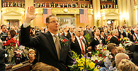 Republican Majority Whip Stan Saylor R-York, left, takes his oath of office during the swearing-in day at the Pennsylvania General Assembly Hall Tuesday, Jan. 4, 2011 in Harrisburg, PA. (AP Photo/Bradley C Bower)