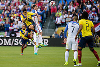 Seattle, WA - Thursday, June 16, 2016: Ecuador midfielder Cristian Noboa (6) goes up for a header against United States midfielder Alejandro Bedoya (11) during a Quarterfinal match of the 2016 Copa America Centenrio at CenturyLink Field.