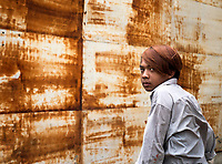 A teenager with rusty hair and rusty background, Phnom Penh, Cambodia