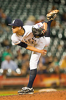 Rice Owls relief pitcher Zech Lemond #33 follows through on his delivery against the Texas Longhorns at Minute Maid Park on March 2, 2012 in Houston, Texas.  The Longhorns defeated the Owls 11-8.  (Brian Westerholt/Four Seam Images)