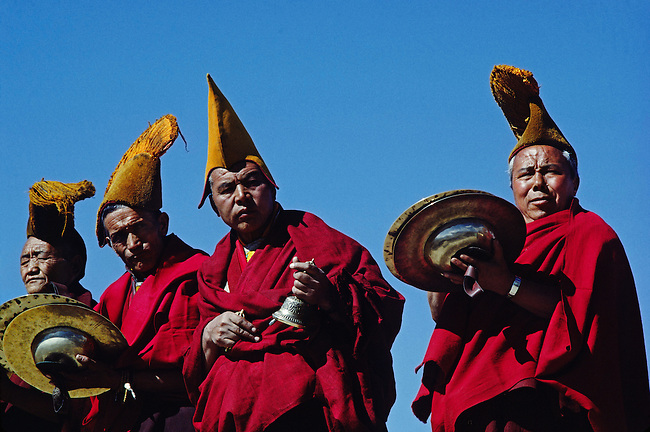 GELUG (yellow hat) MONKS PLAY MUSIC on a rooftop overlooking the TIKSE Monastery GOSTOR (mask dances) - LADAKH, INDIA