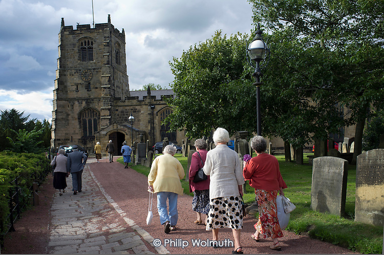 Elderly worshippers arrive for a Sunday evening service at St.Michael's Church in Alnwick, Northumberland.