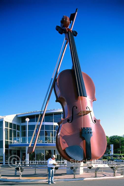 "Sydney, NS, Nova Scotia, Canada - The Big Ceilidh Fiddle (artist / welder: Cyril Hearn) at ""Joan Harriss"" Cruise Pavilion (Model Released)"