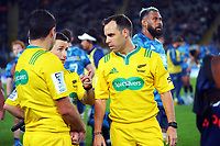 Assistant referee Paul Williams discusses a TMO with referee Mike Fraser (right) during the Super Rugby Tran-Tasman final between the Blues and Highlanders at Eden Park in Auckland, New Zealand on Saturday, 19 June 2020. Photo: Dave Lintott / lintottphoto.co.nz