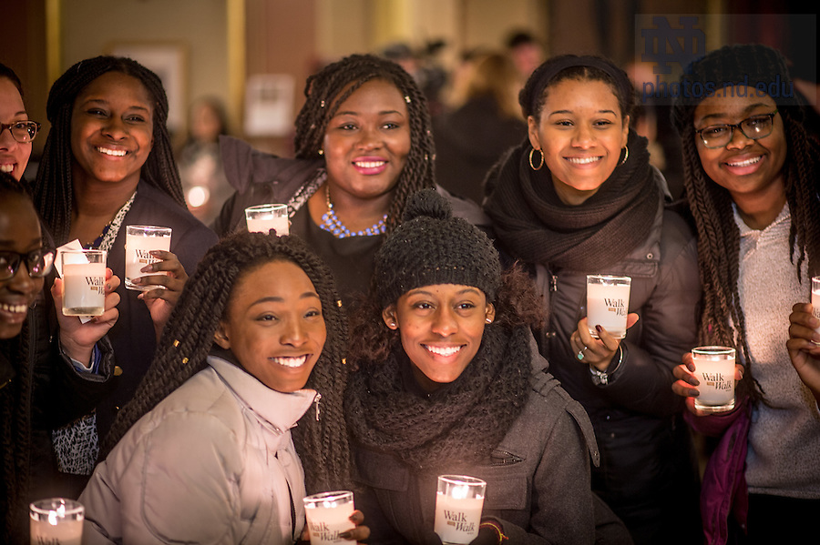 Jan. 18, 2016; Students pose for photos before a midnight prayer service at the Main Building rotunda in honor of the Rev. Martin Luther King Jr. holiday.  The service was the inaugural event of a campus-wide Walk the Walk Week observance, during which students, faculty and staff have been asked to reflect on the values central to Martin Luther King Jr.'s legacy and the mission of Notre Dame. (Photo by Matt Cashore/University of Notre Dame)