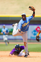 Hanser Alberto (3) of the Myrtle Beach Pelicans turns a double play as Martin Medina (21) of the Winston-Salem Dash slides into second base at BB&T Ballpark on May 7, 2014 in Winston-Salem, North Carolina.  The Pelicans defeated the Dash 5-4 in 11 innings.  (Brian Westerholt/Four Seam Images)