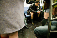 22 January 2006 - New York City, NY - Participants in the 5th annual No Pants Subway Ride travel on the #6 line without pants in New York City, USA, 22 January 2006. The artists and pranksters of the Improv' Everywhere group organised the ride, which gathered over 150 participants, in order to surprise and amuse other passengers and themselves. The police issued summons and handcuffed several participants despite the fact that riding the New York subway without pants is legal. Photo Credit: David Brabyn.