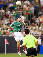 Mexico's Jose Francisco Fonseca leaps for a header. USA 2, Mexico 0, at the University of Phoenix Stadium in Glendale, AZ on February 7, 2007.